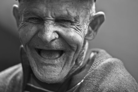 grayscale-photo-of-laughing-old-man-156731.jpg
